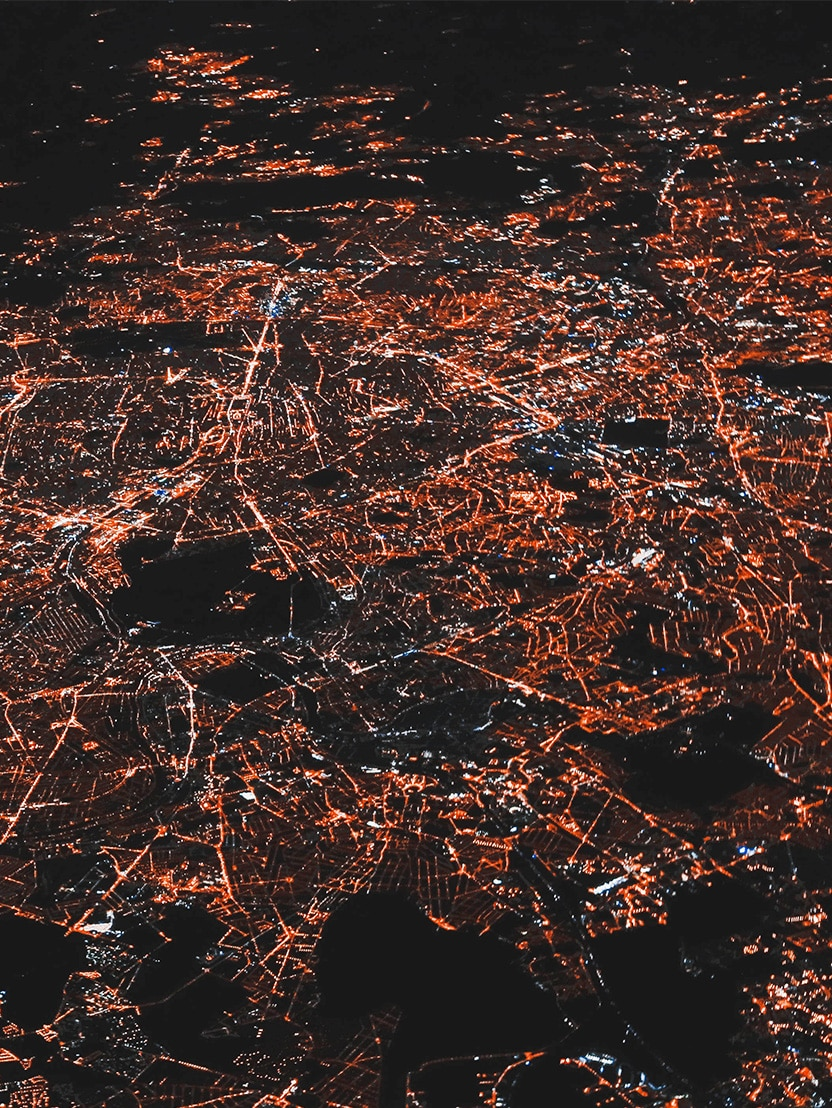 aerial of city at night