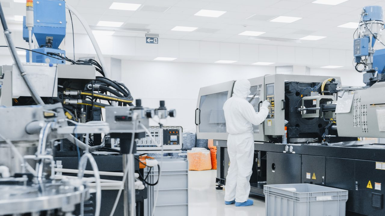 worker in clean suit semiconductor