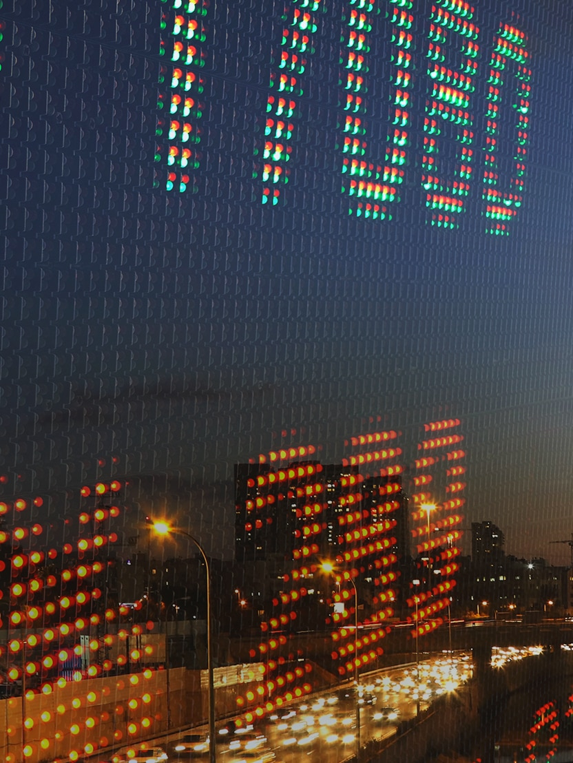 Screen numbers with city reflection