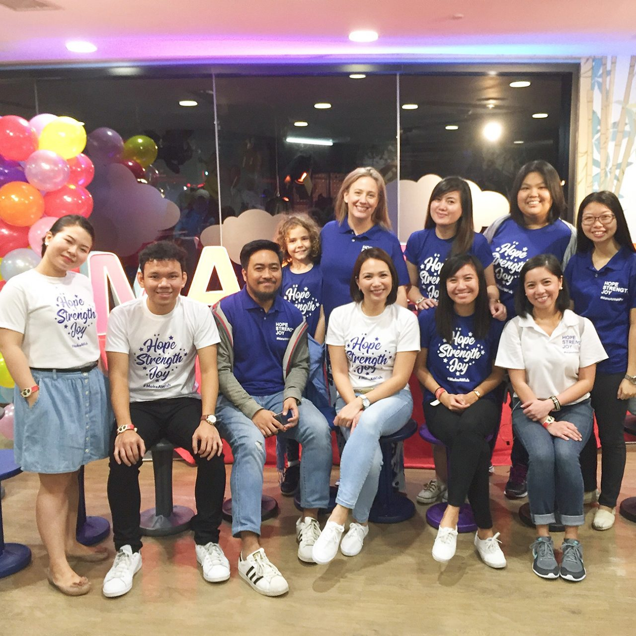 Staff in Manila sold t-shirts to raise money for the children's charity Make a Wish Foundation