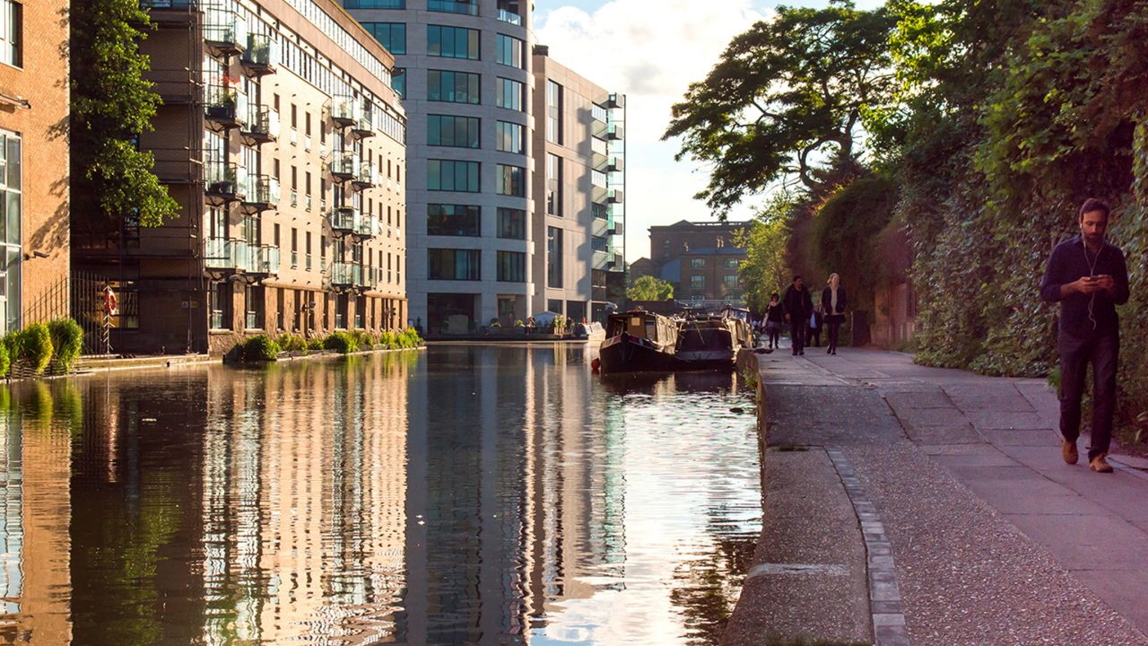 Pedestrians walk on the towpath of the Regent's Canal near King's Cross in north London