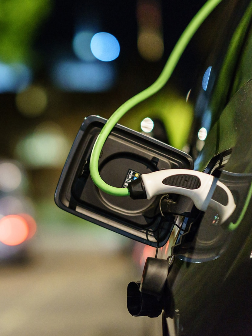 Electric car charging at night