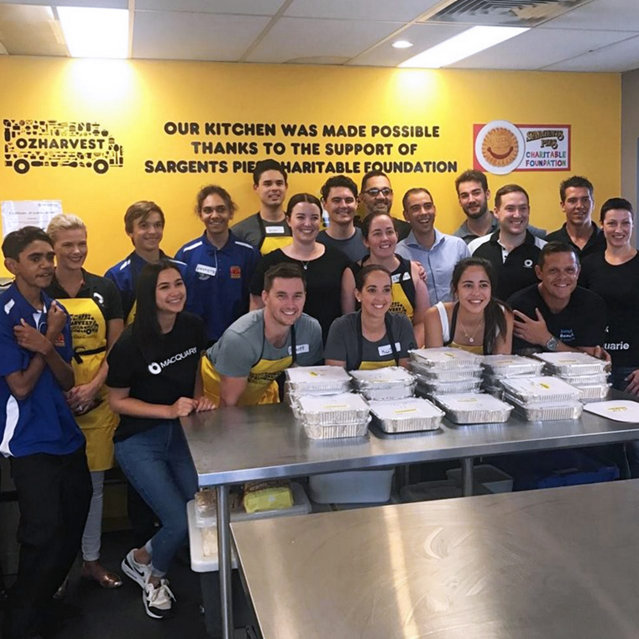 Brisbane staff volunteered with the Clontarf Foundation and OzHarvest, preparing food for the homeless