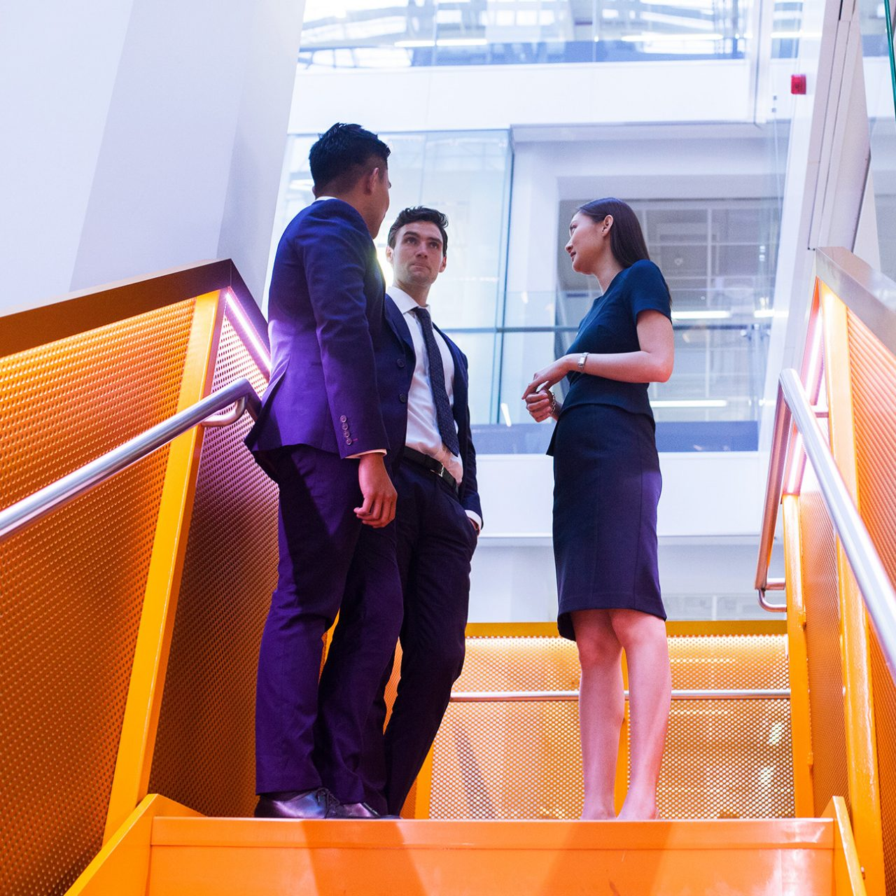 People meeting on the stairs at 50 Martin Place, Sydney office
